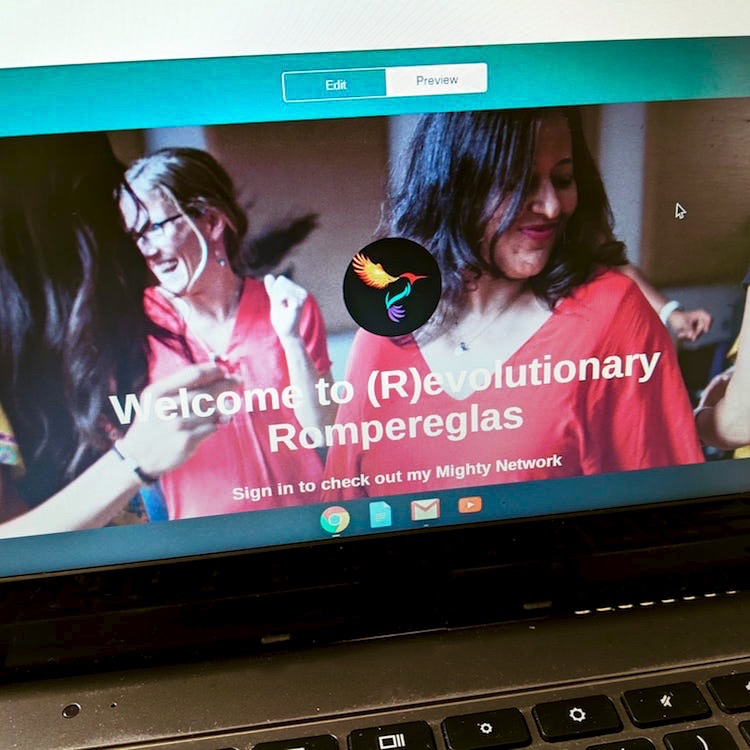 """screen and partial keyboard of computer laptop, on the screen are women dancing, hummingbird logo, words: """"Welcome to (R)evolutionary Rompereglas"""""""